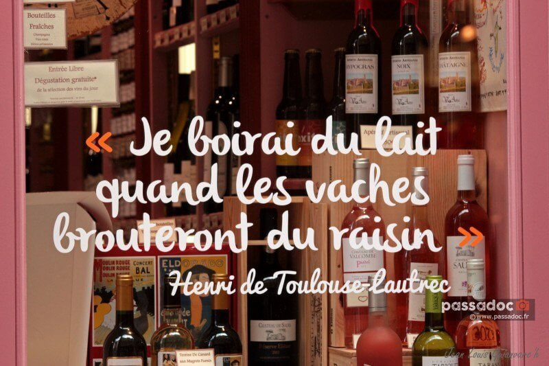 Vitrine d'un magasin avec une citation Toulouse Lautrec - Je boirai du lait quand les vaches brouteront du raisin - photo Jean-Louis Guianvarch site https://jlg.aminus3.com